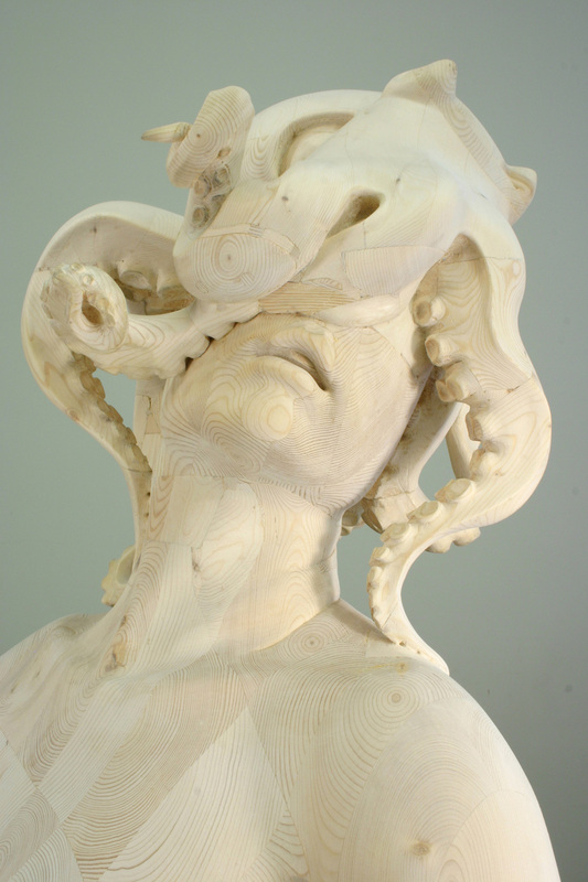 Image of a sculpture, a woman in a classic, upwards gazing head pose with an octopus on covering her face